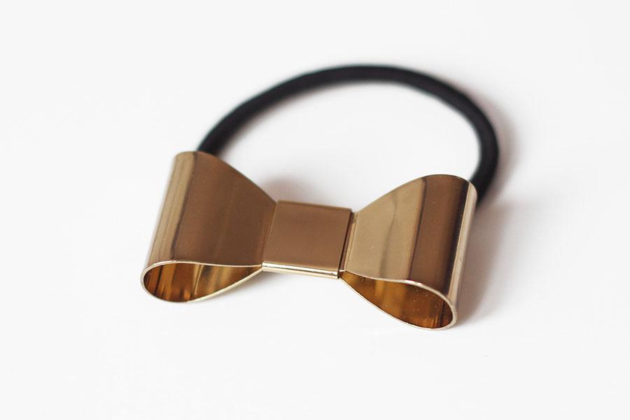 Accessoires Elite Models / Élastique nœud doré